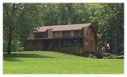 B4UBUILD.COM - Log home with gambrel roof and shed dormers