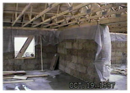 A picture of a garage in a straw bale house b4ubuild com for Straw bale house cost per square foot